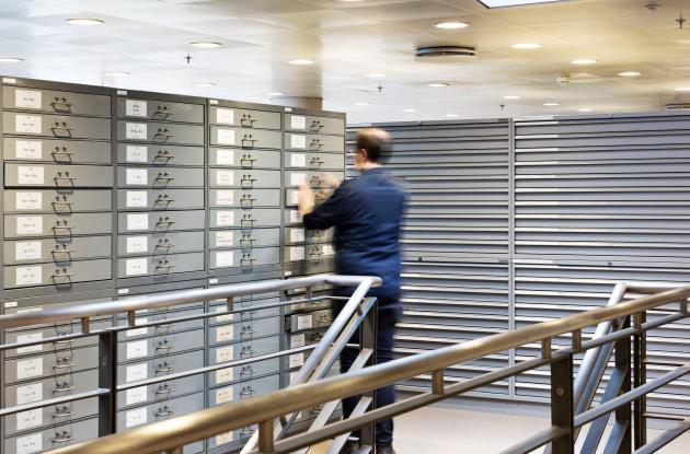 Employee among drawer shelves